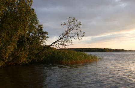 Large river Volga in the dusk with red sunlight