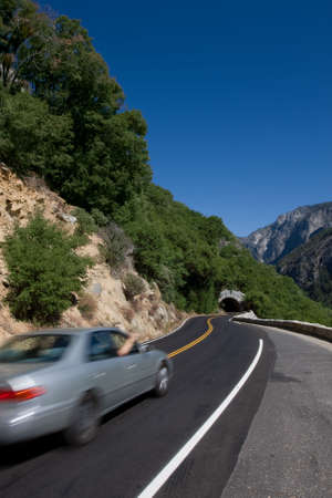 Car in motion on the road of California