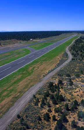 Runway from birds eye view in helicopter with blue sky Stock Photo