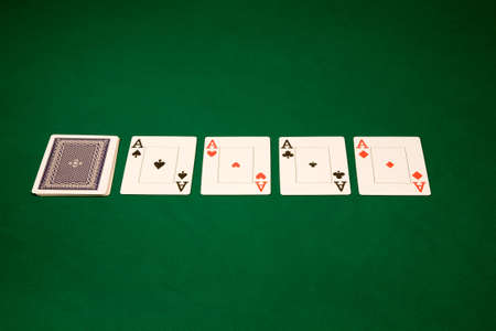 Four of a kind Aces in Las Vegas casinoon the green table