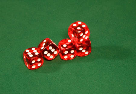 Red dices on the green table in the casino Stock Photo
