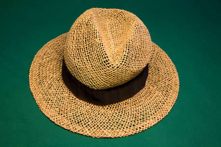 Straw hat on the green casino table Stock Photo