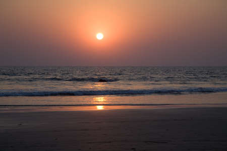 Sunset on the beach in north Goa near the ocean