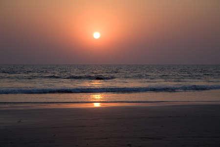 Sunset on the beach in north Goa near the ocean