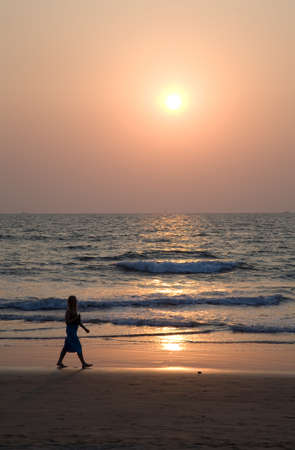 Silhouette of girl over sunset in Goa
