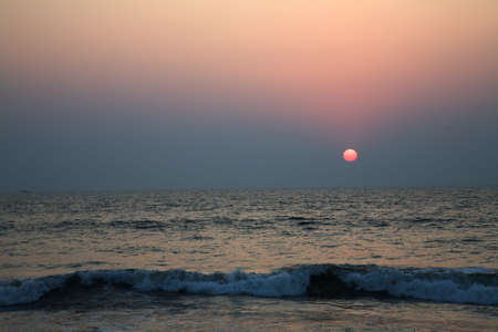 Sunset in the Arabian sea in Goa over blue sky Stock Photo
