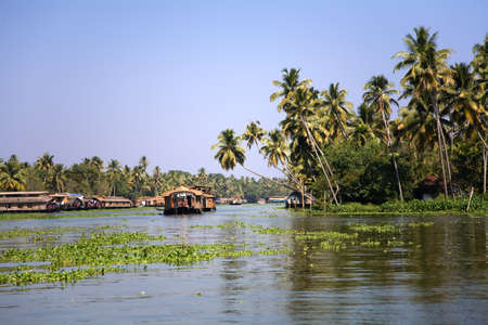 House boats in the backwaters Kerala over blue sky