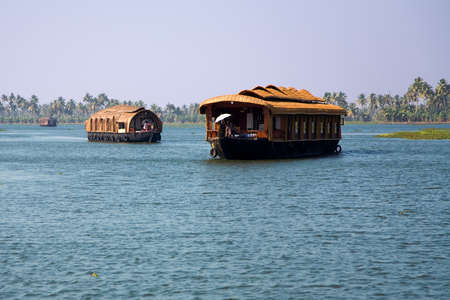 backwaters: House boats in the river of Kerala in India