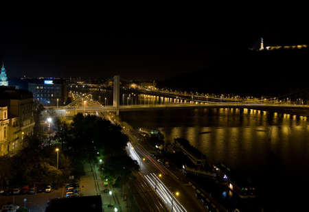 Budapest at night with blured traffic lights over river Danube