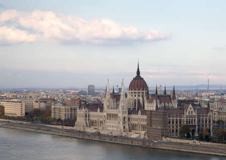 Budapest parliament on the river Danube with blue sky