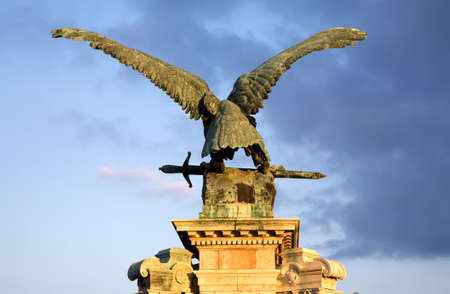 Antique sculpture of eagle in Budapest over blue sky Stock Photo