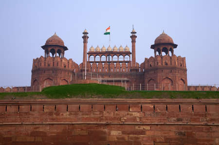 Antique indian red fort in Delhi with flag Stock Photo