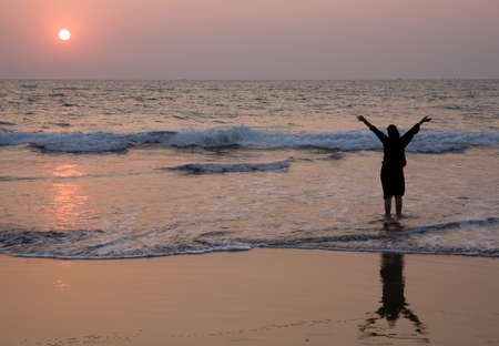 Happy girl have fun on the beach at dusk time Stock Photo