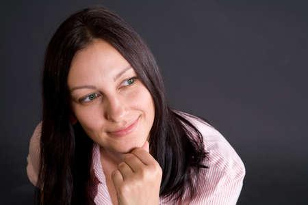 Pretty caucasian girl over gray in studio Stock Photo