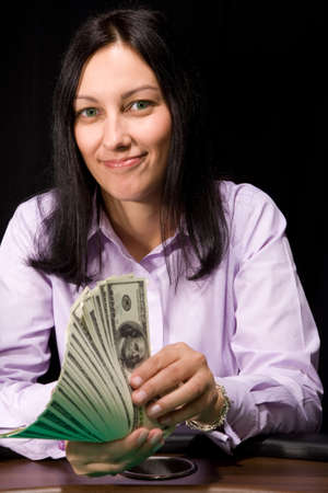 Pretty caucasian girl holds cash in hands in casino photo