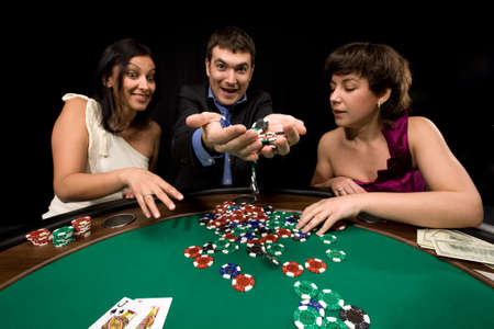 Stylish man wins in the casino over black Stock Photo