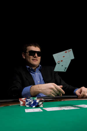 Flying cards in texas hold'em poker over green casino table Stock Photo
