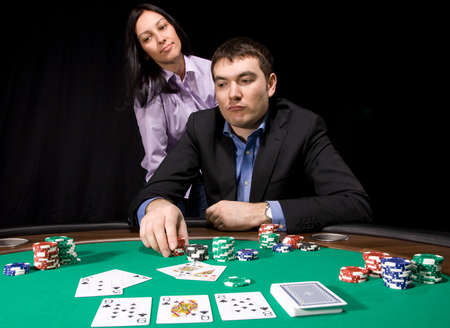 Couple in the casino playing poker on green felt Stock Photo - 4630744