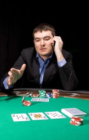 Attractive young caucasian man make bet in the casino Stock Photo - 4630746