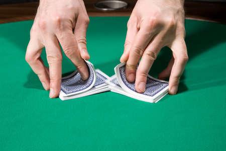 Dealer shuffle cards in casino over green felt Stock Photo - 4630748