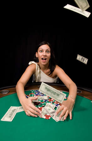 Dollar bills flows from sky in casino over black