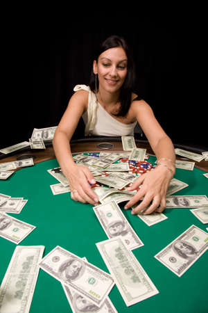 Pretty caucasian girl wins cash in Vegas casino