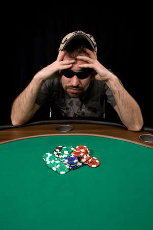 Caucasian man wins a lot of casino chips over black photo