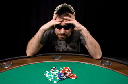 Caucasian man wins a lot of casino chips over black Stock Photo - 4630740