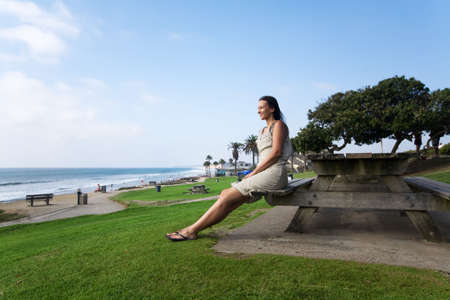 Caucasian woman relax on the california beach over green grass