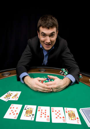 Caucasian man win with four of a kind in casino poker Editorial