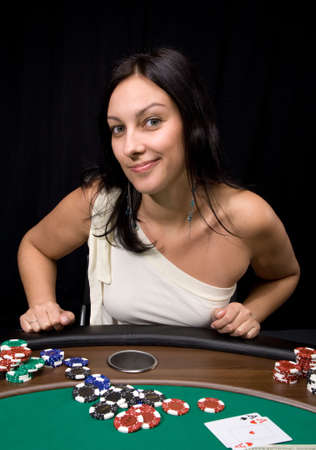 Pretty caucasian girl shows two aces in casino poker and win! Stock Photo
