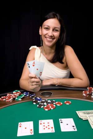 Attractive young caucasian woman wins with two ace in the casino