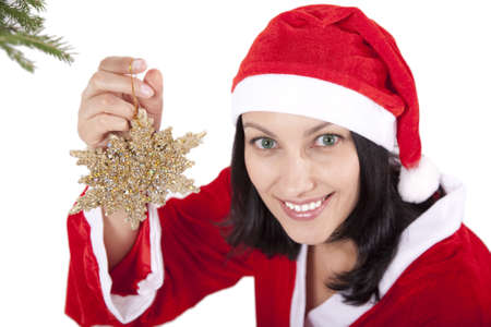 Smiling girl in christmas cap with toy in hand over white Stock Photo