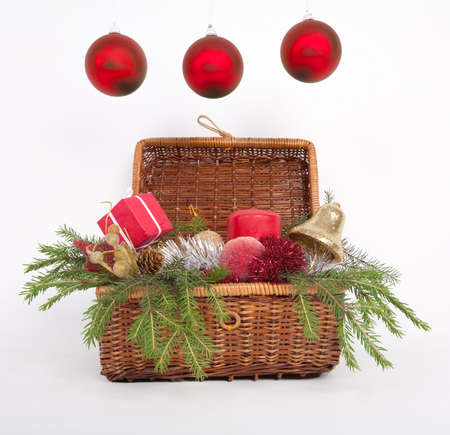 Wooden box with Christmas gifts with green fir over white