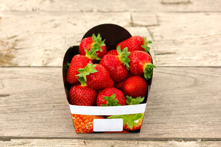 mouthwatering: A basket of mouthwatering freshstrawberries on table