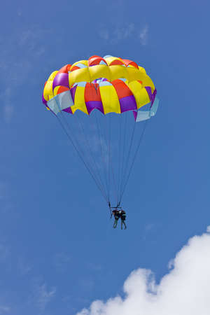 gliding: two people parasailing against a clear blue sky Stock Photo