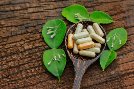 herbal medicine in capsules for healthy eating with organic herb