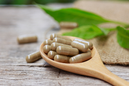 Powder herbal capsules from organic herb for healthy eating