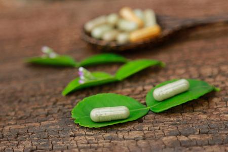 Herbal powder capsules for healthy eating from organic herb 版權商用圖片
