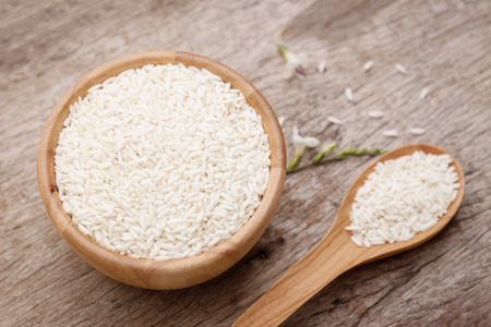 Raw paddy rice on wooden bowl