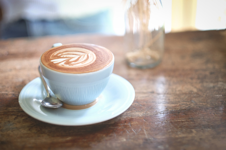 Coffee latte on blue cup for healthy drinking
