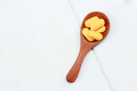 Herbal supplement on wooden spoon for healthy eating