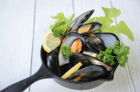 cooked mussle salad in pan for eating