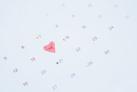 Heart shape on calendar at 14 February for Valentine concept day