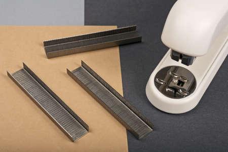 office stapler: Office stapler on a colour paper