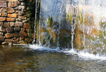 Water cascade in summery landscape.