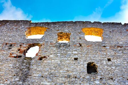 fortify: The stone castle wall against blue sky.