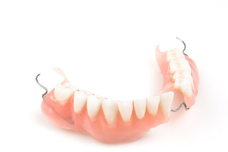 denture: Lower denture with braces isolated on a white background. Stock Photo