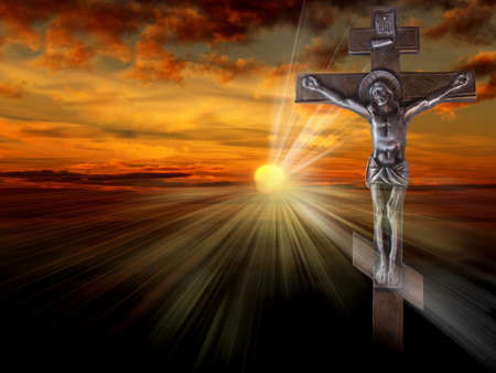 Silhouette of the crucified Jesus Christ on the cross against the red sky. The Biblical prophet is a symbol of death. Christmas, Easter background. Stock Photo