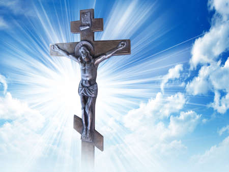 Silhouette of the crucified Jesus Christ on the cross against the blue sky. The Biblical prophet is a symbol of death. Calvary, Christmas, Easter background.